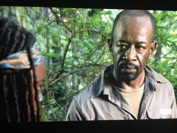 He looks over at Michonne.