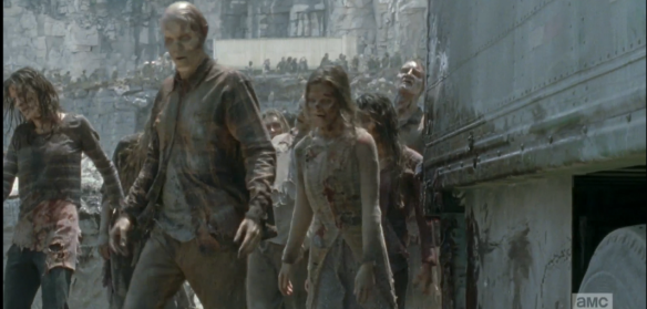 As one of the trucks pulls away, according to plan, the walkers spill out of the opening.