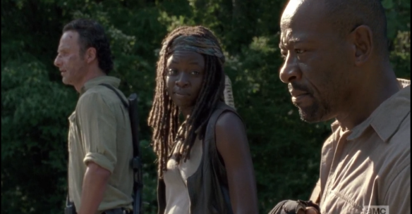 Michonne looks over at Morgan, her face softening with inner mirth, and she answers quietly, with a smile in her voice,