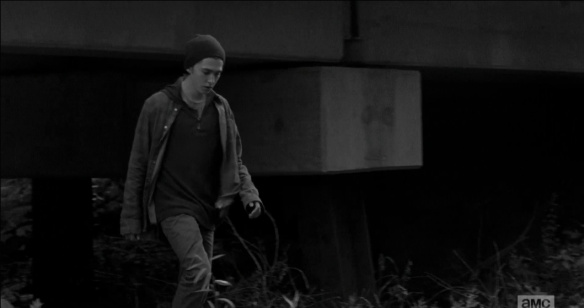 In the next shot, time shifts back, again, and we see Ron, coming out from under a bridge, alone.